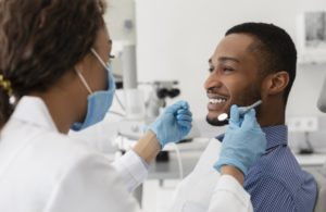 young man asking his dentist about root canal myths