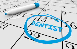 Dental checkup reminder circled on calendar